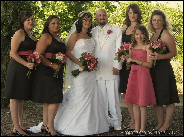 Bridesmaids with bride and grrom